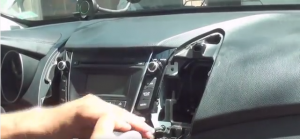 Take 4 screws out which securing radio chassis to sub dash