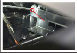 Use a screw driverremove the screw marked with a red circle  to release the car charger and ashtray
