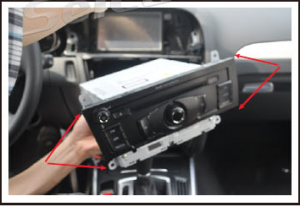 Remove four screws which fixed the original CD player and take out the player