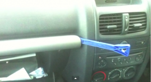 Pry the trim above the glove box off