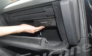 11. Use the support to fixed the GPS box on the glove box.
