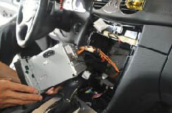 12. Please be careful not to stretch the wiring harness behind the assembly.