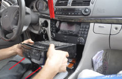 3. Remove two screws under the 6-disc CD changer and take out the CD changer