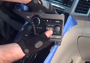 4. Disconnect the connectors at the rear of the ac control