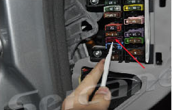 7. Pry the decoration panel beside the driver's seat, change fuse from 5A TO 10A