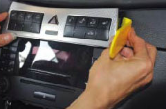 8. Remove the heated seat and control panel assembly.