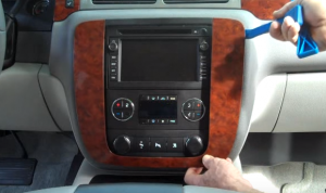 Remove the trim panel by prying the edges with a lever