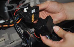 Insert the plug of the car into the socket of unit
