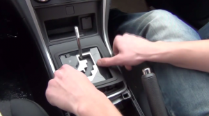 Remove the shift trim panel with your fingers