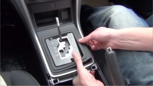 Remove the shift trim panel with your hands