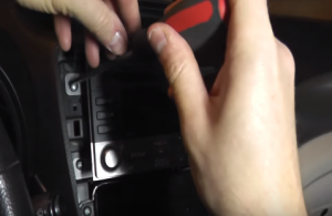 Remove four screws that fixed the stereo on the dashboard
