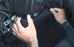 Remove steering wheel column panel by pulling back to release clips