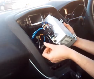 Unplug the connectors at the back of the car radio