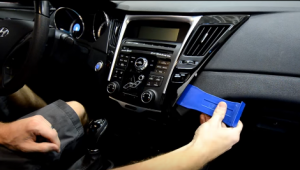 Pry the trim panel with a plastic removal tool to remove the panel