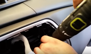 Remove two top screws that are holding the radio