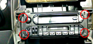 Remove 4 screws which holds the factory radio in place