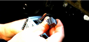 Disconnect the smaller harness on the behind of the factory radio