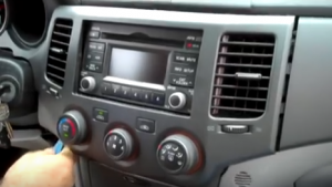 Pop out the dash panel part along with AC control panel with a plastic removal tool