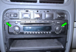 Remove 2 screws holding the stereo in the dashboard frame (green arrows). Please note that there will be four screws in the cars with navigation