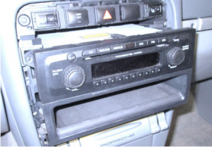 Carefully take the factory stereo out of the dash. When removing the factory radio, please note that there are two locking tabs on the lower tray that can break easily