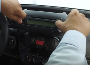 Pull outwards to remove the original radio