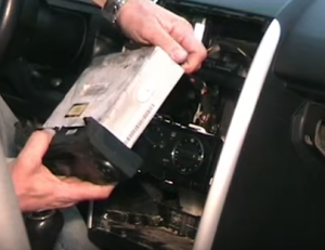 Unplug the connectors at the back of the original radio