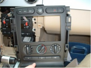 Remove the radio bezel and AC controls