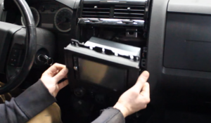 Gently pull the original car radio out from the original car radio