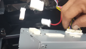 Unplug the connectors and cables at the back of the original car radio