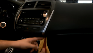 Use a plastic knife to pry the trim panel and remove it
