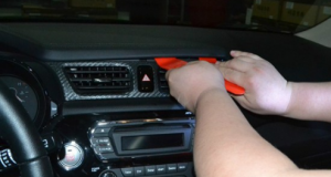 Use a plastic removal tool to release the top panel