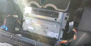 If you need to remove the original car radio, then just remove these mounting screws and then remove the car radio. Then you should disconnect the connectors at the back of it