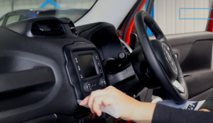 Start by removing the car radio trim panel using a flat pry tool